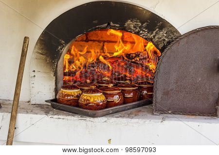 wood-burning stove with food in pots.