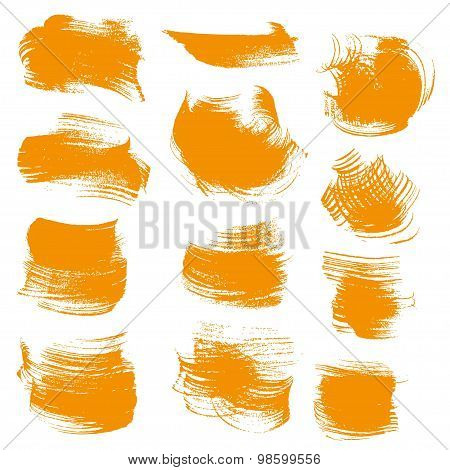 Abstract Orange Gouache Smears Isolated On A White Background
