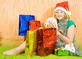 foto of tawdry  - new year girl with two pet rabbits sitting in home - JPG