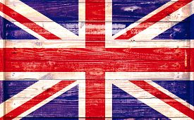 pic of british culture  - British flag on a grungy wooden textured background - JPG