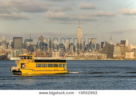Liberty State Park Ferry on Hudson River with Mid-Town Manhattan in the background.