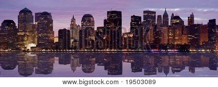 Lower Manhattan at Dawn with reflection in Hudson River.