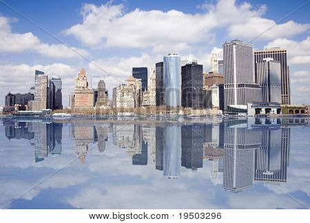 Lower end of Manhattan with reflection as seen form New York Harbor.
