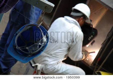 A Repair Man Busy Welding