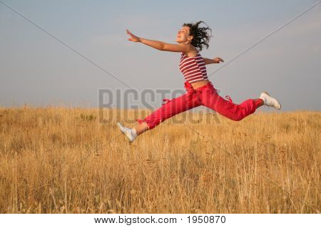 Woman Jump On The Meadow