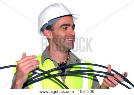 Smiling Construction Worker With A Cable
