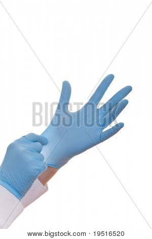 Hands of a medic in the blue latex gloves