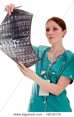 Female doctor looking at xray picture 21 megapixel