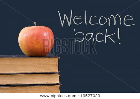 Welcome back! written on chalkboard with apple, books