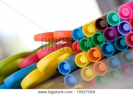 school supplies - colorful markers and scissors - very narrow DOF