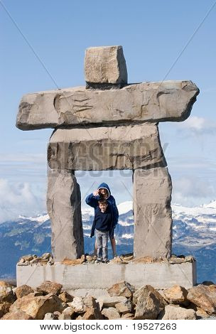 inukshuk with two children - traditional inuit symbol for 'the way'