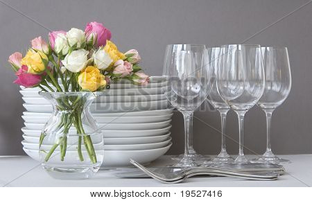 dinnertime - roses, plates, wineglasses and utensils