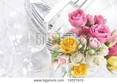 springtime or wedding sparkling buffet dishes and roses