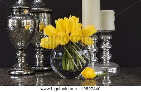 vase of yellow tulips with silver home decor accessories - tablescape