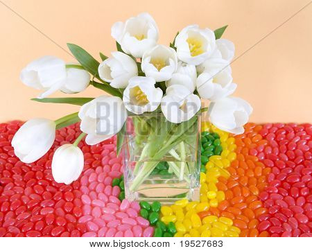 white tulips and rainbow jellybeans for easter
