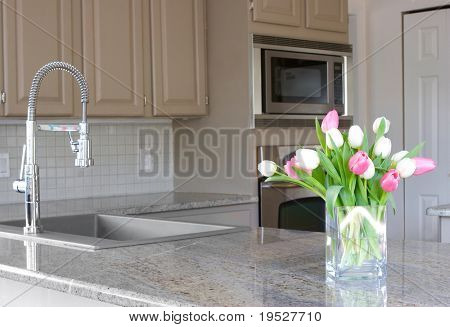 pink and white tulips in a modern grey kitchen