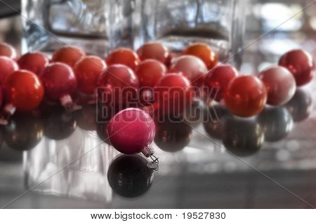 christmas ball on glass table - play of light and shadow