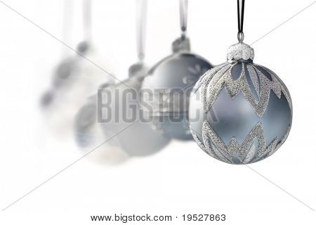 blue grey luxury christmas ornaments on white background - narrow DOF