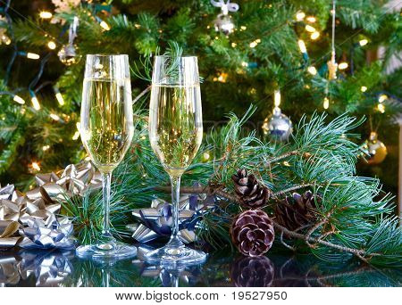 two glasses of champagne on green christmas background