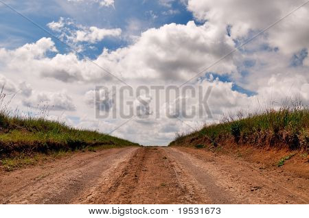 rural dirt road and cloudscape