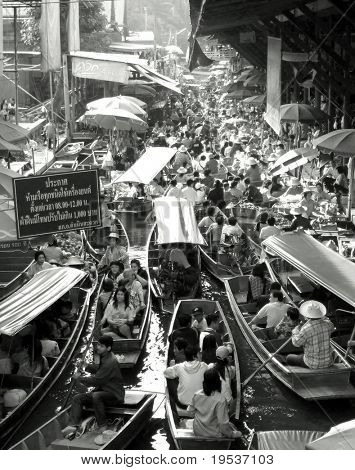 Black and white image of traditional floating market near Bangkok, Thailand.