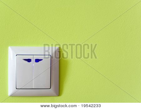 switch outlet on green baskgrounds