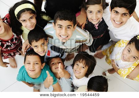 Large group of happy children, different ages and races, crowd