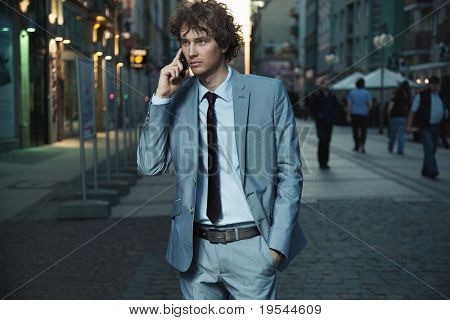 Young handsome man on evening city street