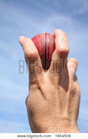 Close Up Of A Seam Bowler Holding A Cricket Ball.