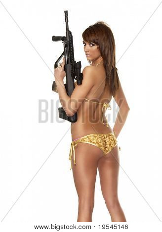 Beautiful sexy blond woman isolated holding army weapon machine gun