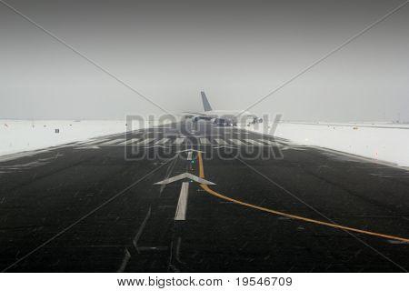 airplane wing aircraft turbine landing in snow winter runway