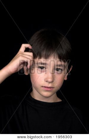Boy Scratching His Head