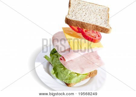 Delicious Ham Sandwich With Whole Wheat Bread Isolated On White