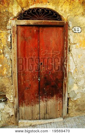 Old textured grungy European doorway background