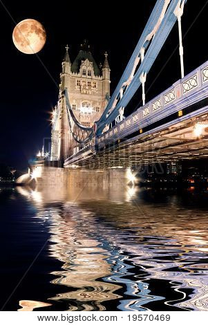 Tower Bridge, London at night reflected in the Thames