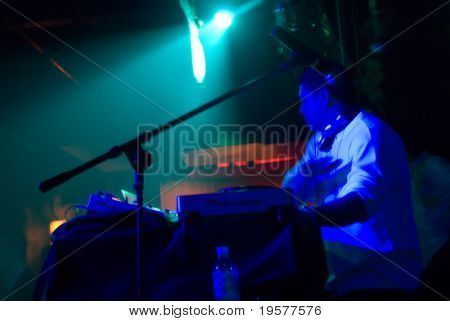 Abstract Dj in motion in nightclub