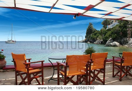 Exotic beach with perfect waves on Paxos Island in Greece. Ideal as background for tourism, leisure and nature designs