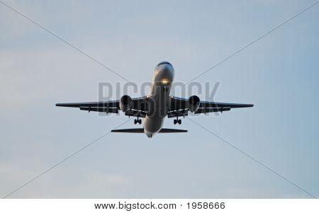 Airplane Against Overcast Sky