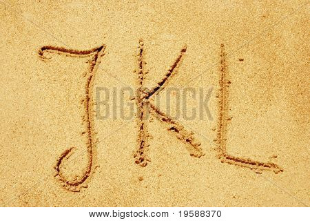 Alphabet letters JKL handwritten in sand ideal for font, nature or conceptual designs
