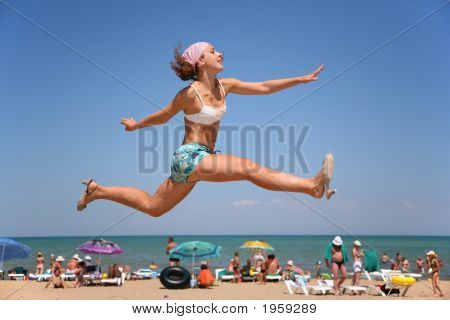 The Woman Jumps On A Beach