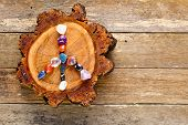 Peace Symbol In Crystals On Circle Of Timber Log Against Old Textured Wooden Background poster