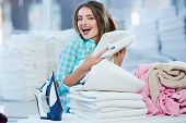 Girl Piling White Linen Into Heap poster