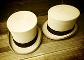 foto of top-hat  - Two old fashioned top hats - JPG