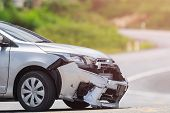 Silver Car Get Damaged By Crash Accident On The Road. Car Repair Or Car Insurance Concept poster