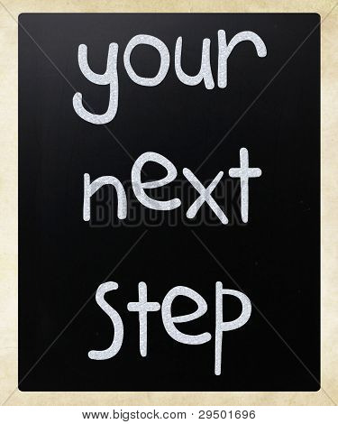 """your Next Step"" Handwritten With White Chalk On A Blackboard"