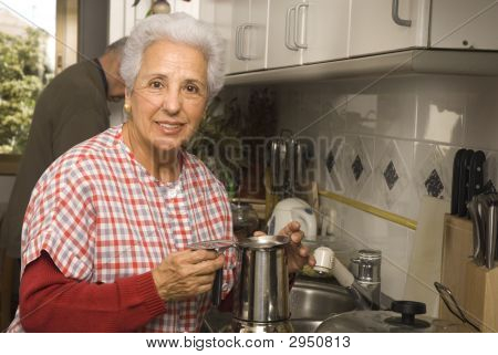 Senior Couple At Kitchen