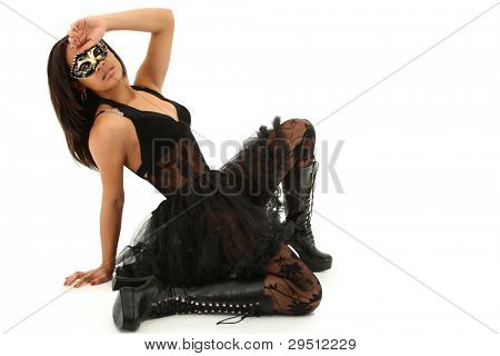 Beautiful Young Black Woman in Mardi Gras Mask over white background.