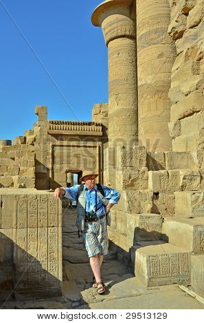 Senior tourist in Kom Ombo ruins, Egypt