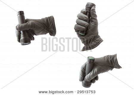 Hand In Glove With A Flashlight