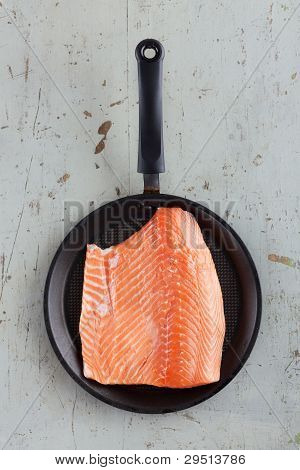 Big Raw Salmon Steak In Frying Pan On Rustic Table
